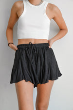 Black flowy shorts with textured design.