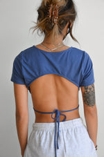 The back of this crop top is open with a back tie detail.