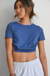 Blue cropped tee with ruched side detailing.