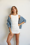 Denim jacket slouched off the shoulder.