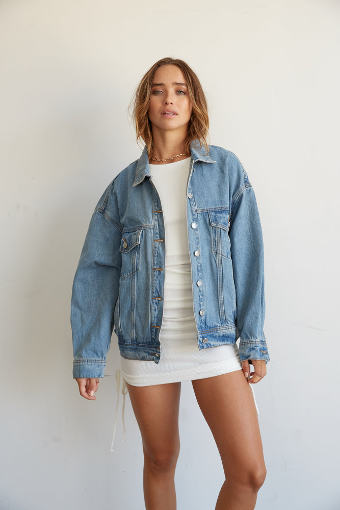 Denim jacket with open front.