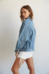 This denim jacket has an oversized silhouette for a vintage feel.