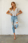 High rise destroyed jeans with flowy crop top.