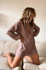 This long sleeves romper is complete with side pockets.