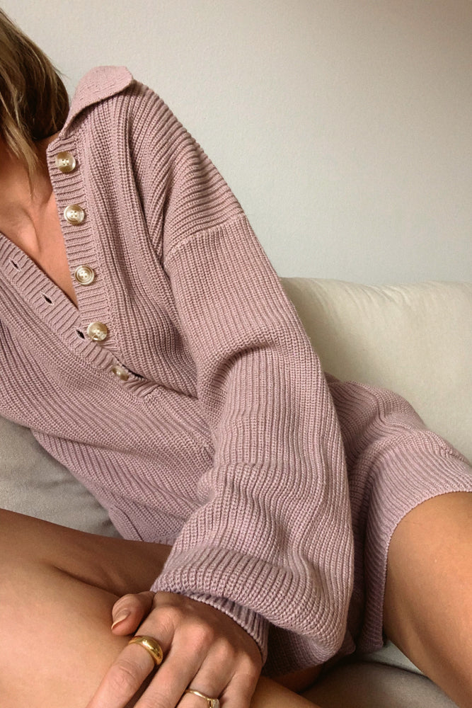 Open collar button up front.
