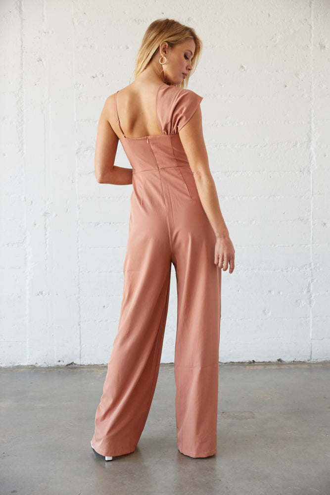 The back of this jumpsuit is relaxed with a back zipper closure.