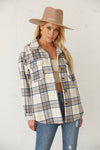 Oversized flannel shirt with button up front.