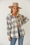 Blue and white flannel with button up front.