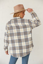 The back of this flannel is boxy and oversized.