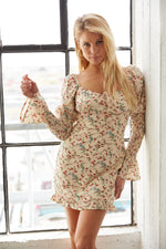 Floral mini dress with sweetheart neckline and smocked puff sleeves.
