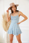 Blue floral romper with ruched bust.