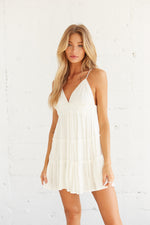 White ruffle mini dress.