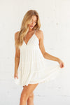 White ruffle mini dress with v neckline.