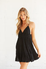 Black ruffle mini dress with spaghetti straps.