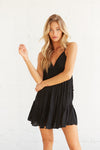 Black ruffle mini dress.