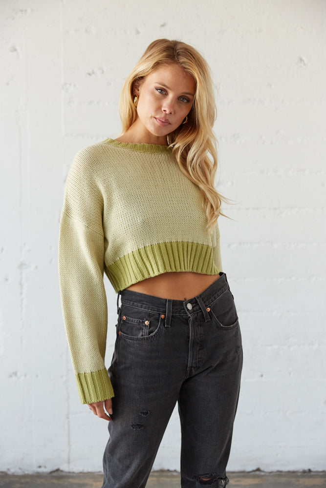 This crop knit sweater has a ribbed hem.
