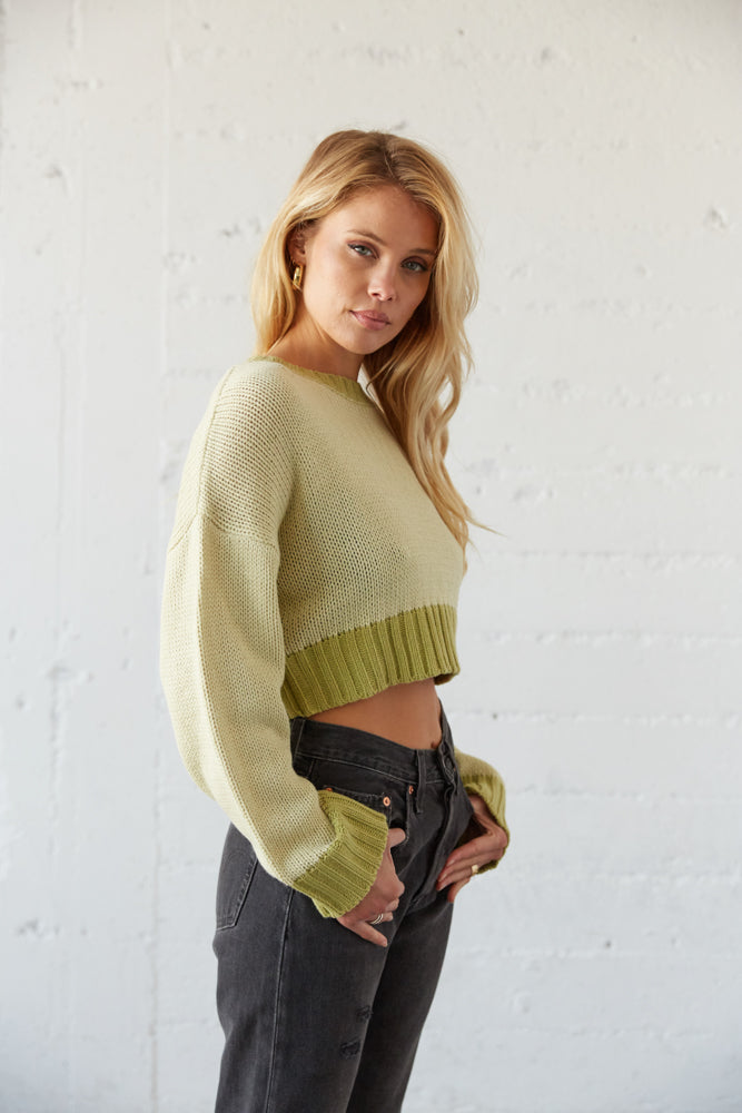 The side of this sweater shows off the long sleeves and ribbed hem.