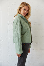 The side of this jacket shows off the pockets and relaxed long sleeves.
