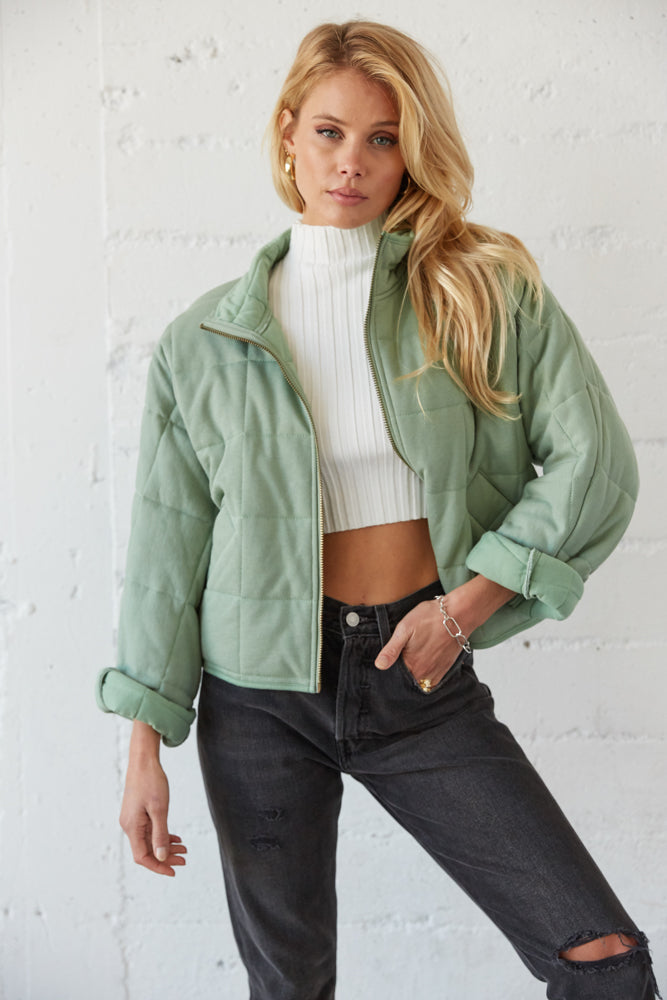 Green quilted jacket.