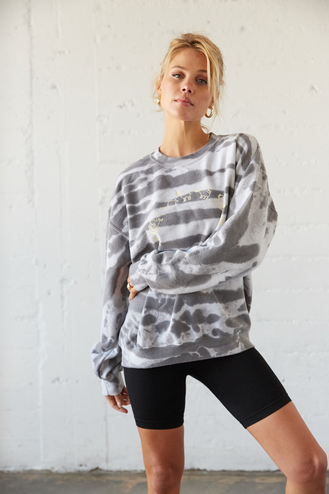 Oversized sweatshirt with gold celestial design.