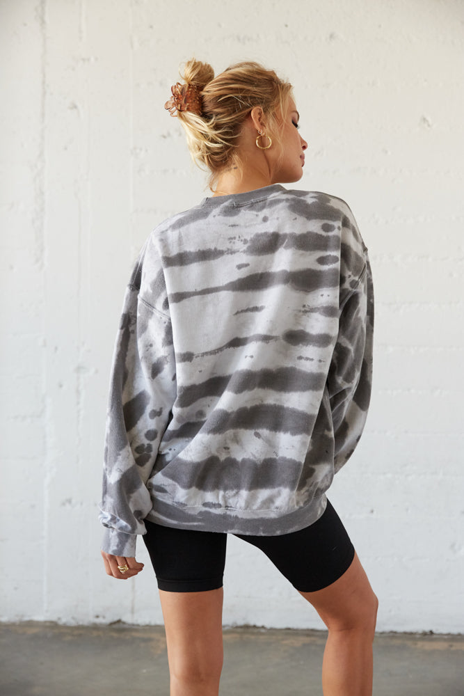 The back of this sweatshirt is bleached and oversized.