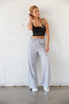 Heather grey high rise sweatpants with slit above the knee.