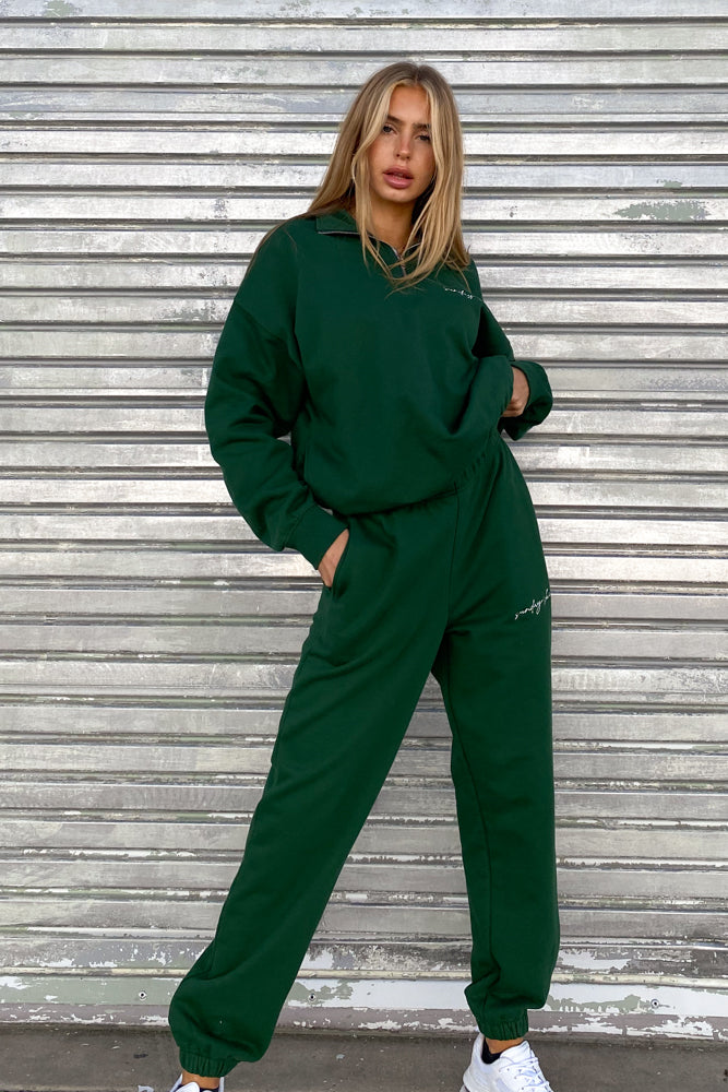 Hunter green sweatpants with matching sweatshirt.