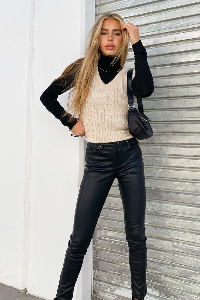 Black vegan leather leggings with tan vest.