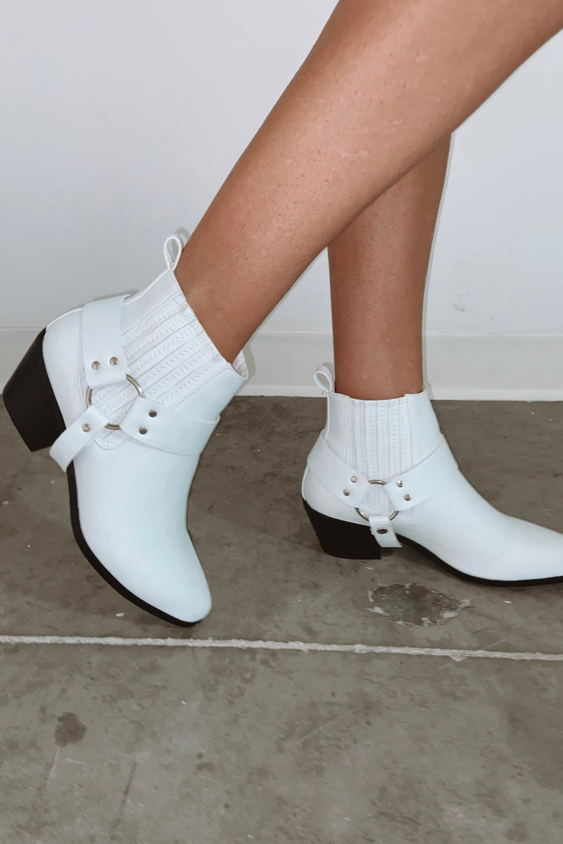 White booties with buckle detail.