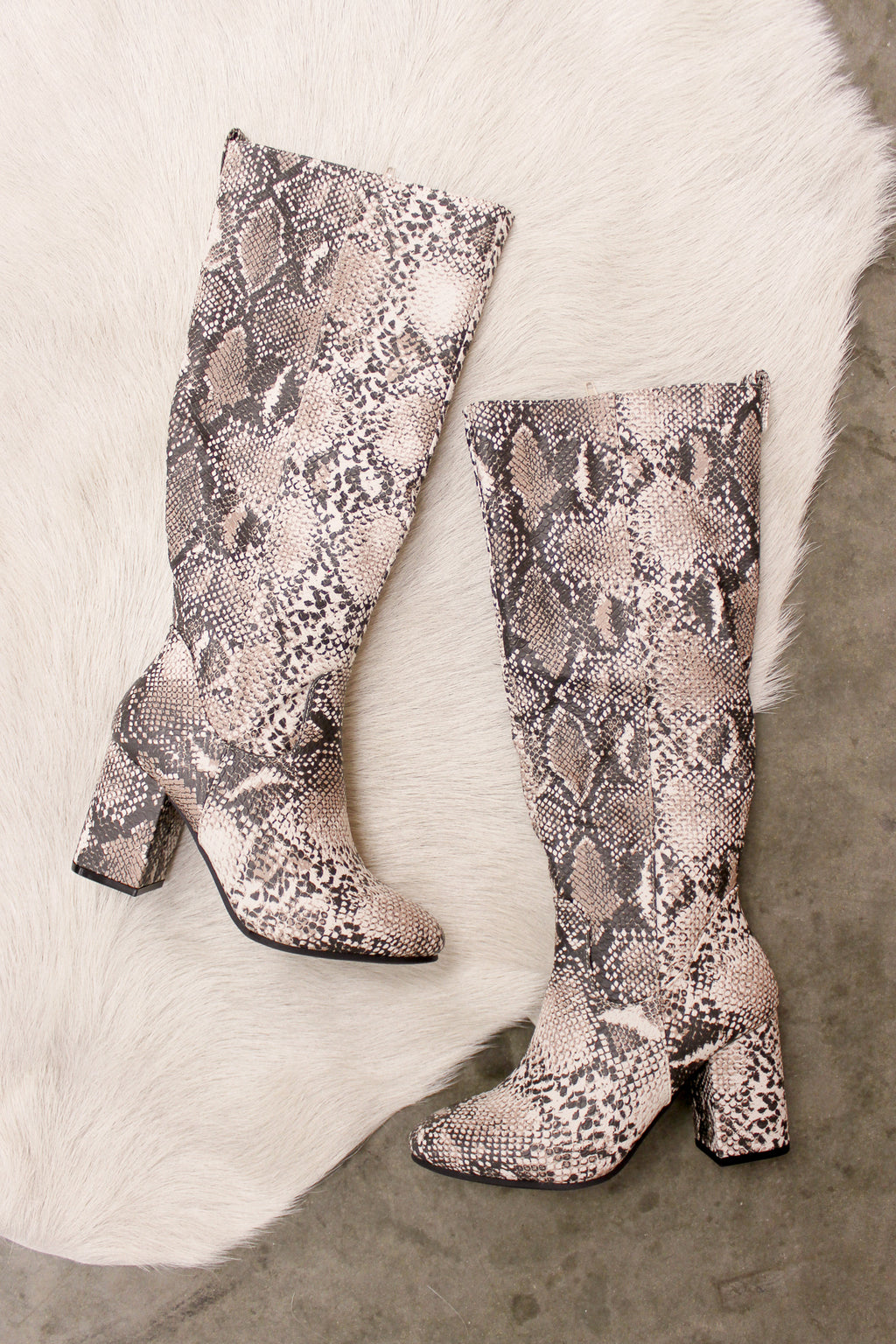 Snakeskin slouchy boots.