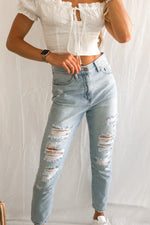 High rise distressed jeans.