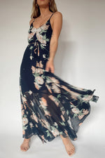Flowy maxi dress with belted waist.
