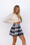 The side of this plaid tennis skirt is relaxed.