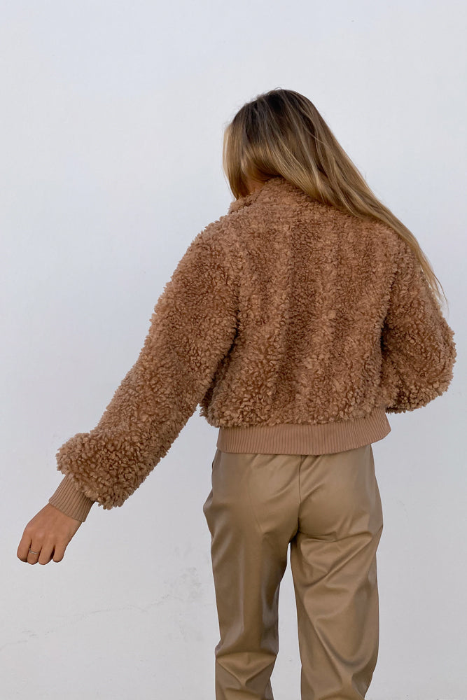 The back of this fuzzy jacket is cropped and relaxed.