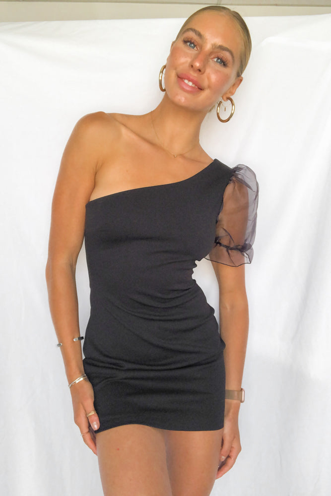Black one shoulder dress.