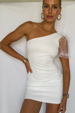White one shoulder dress.