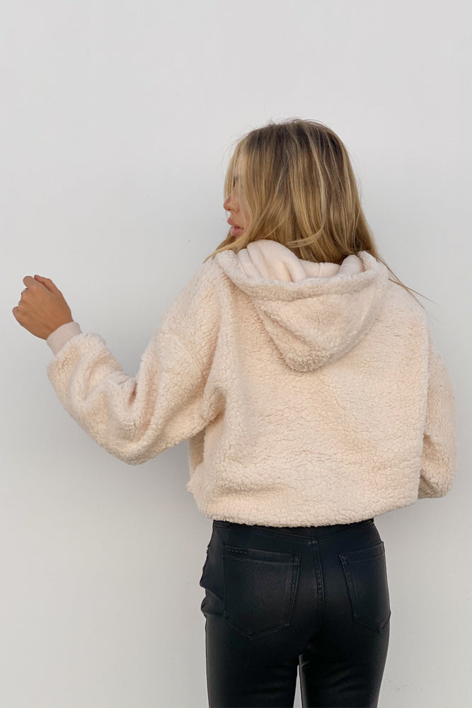 The back of this crop teddy jacket is cropped with a hood.