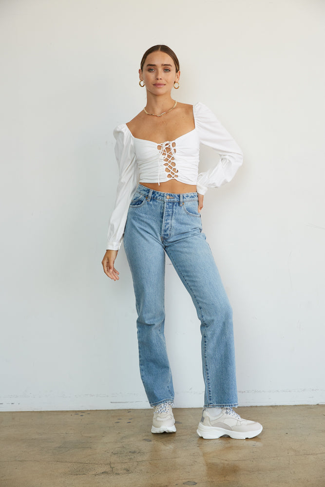 White long sleeve top with lace up detailing.