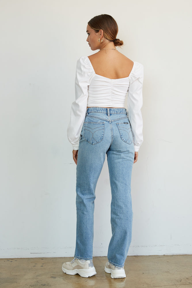 The back of this crop top has a ruched back and long sleeves.