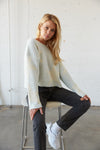 Soft knit star printed sweater with long sleeves.