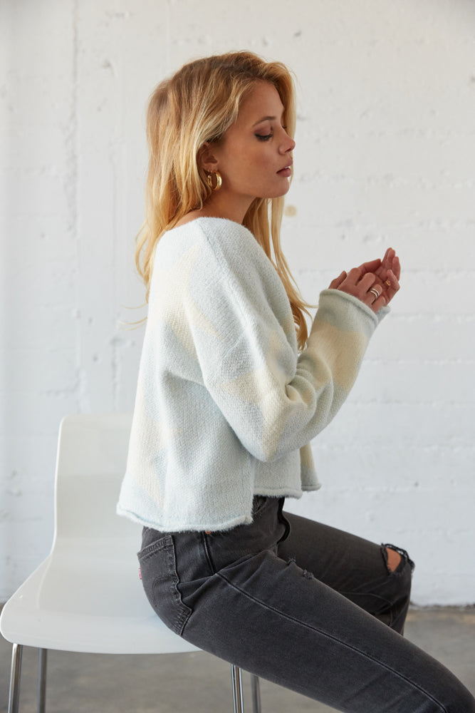 The side of this sweater shows off the rollover hem.