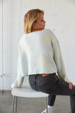 The back of this sweater has a soft knit design and stars.