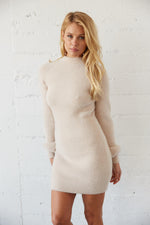 Sweater dress with mock neckline.