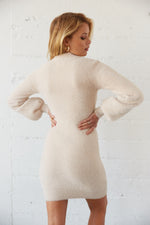 The back of this dress is fitted with a ribbed hem.