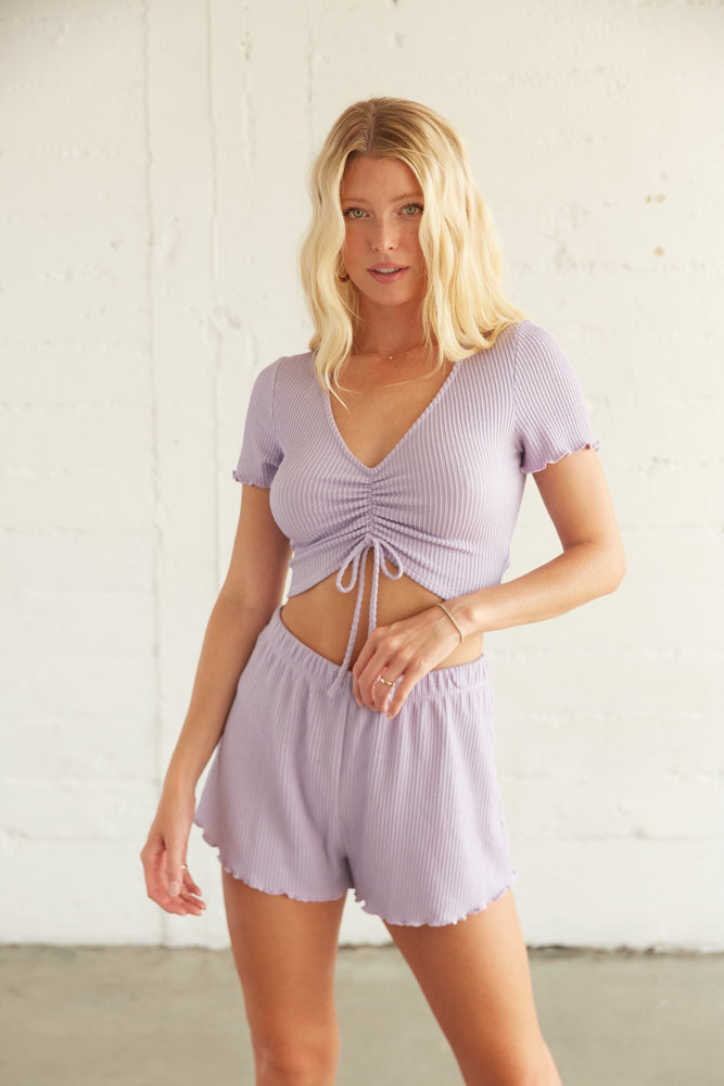 Purple Short set with cinched tie detail and high rise shorts.