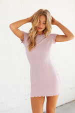 Lavender mini dress with crew neckline.