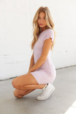 Side sitting view of light purple mini dress.
