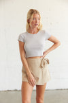 Tan wrap skort with side tie detail.