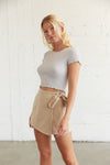 Wrap skort with adjustable side tie detail.