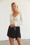 Black wrap skort with side tie detail.